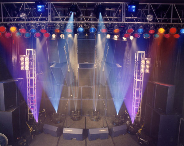 A small stage with blue, white and purple vertical spot lights